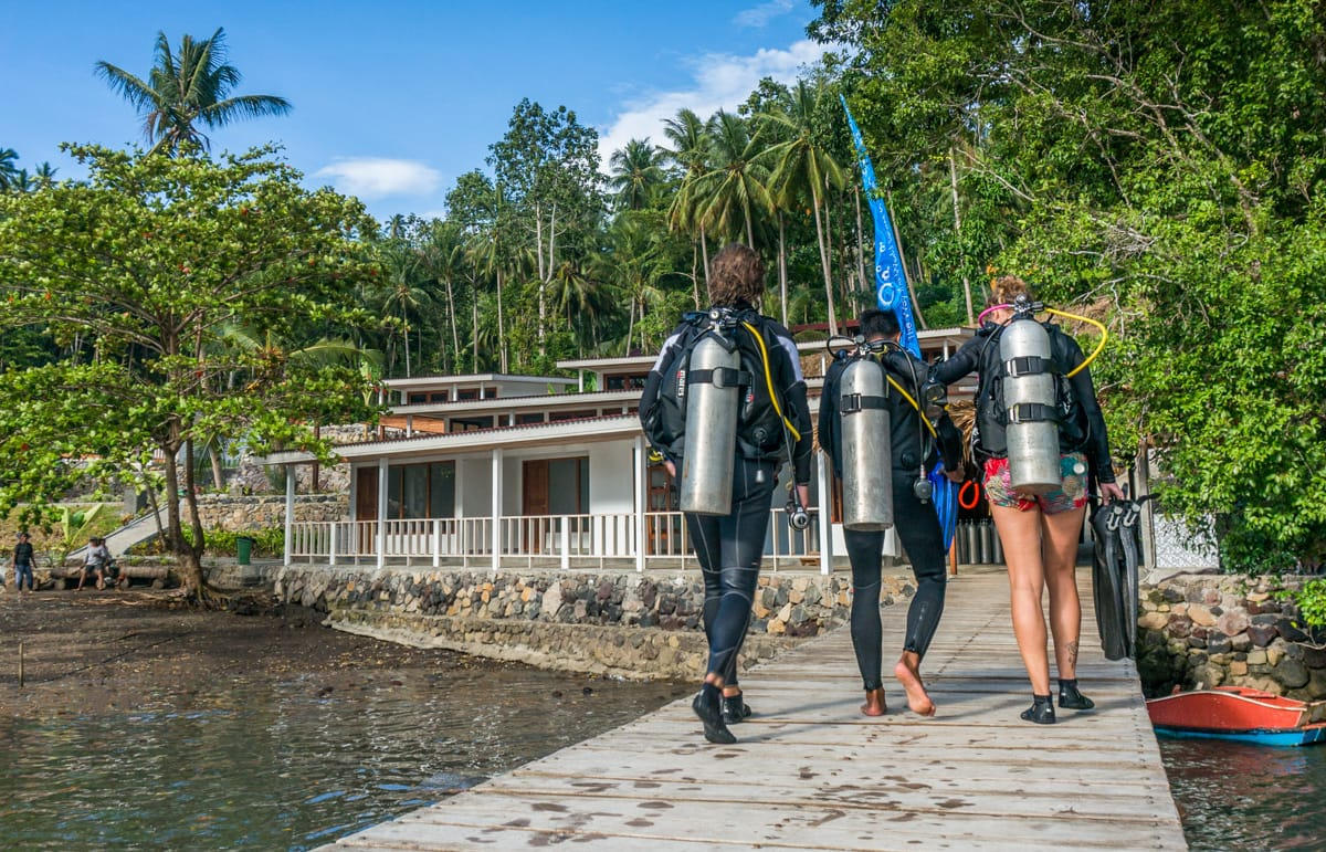 Divers walking on jetty.