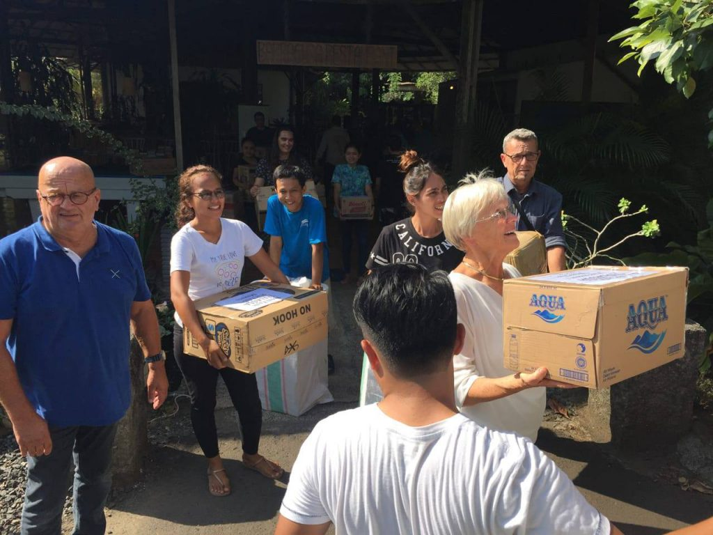 Guests and friends helping out for Palu