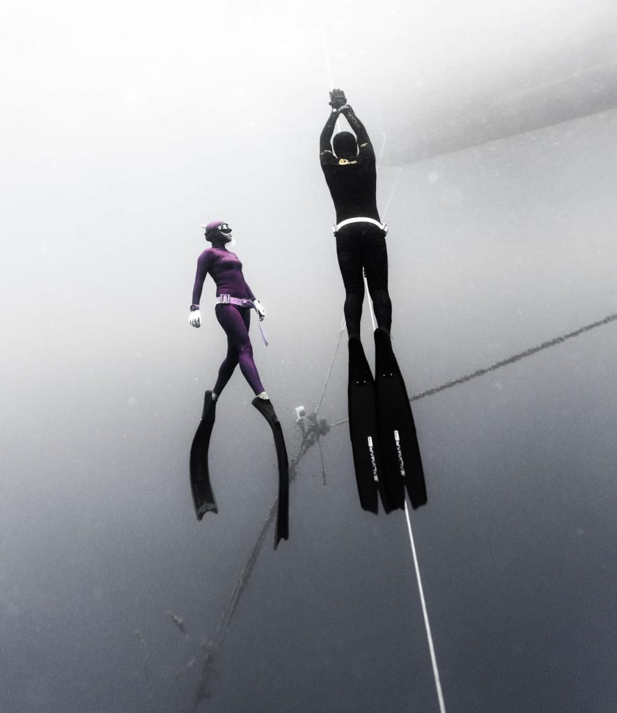 Two freedivers ascending