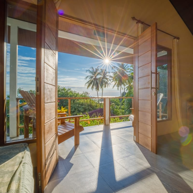 The Bunaken National Marine Park at sunsetThe sun shining through the doorway of a bungalow